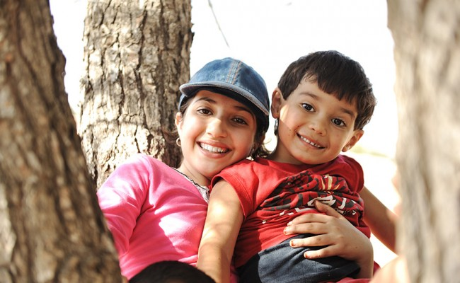 Children in scout camp playing on tree